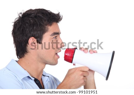 Man speaking into a megaphone - stock photo