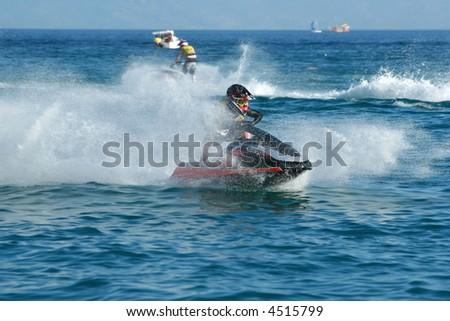 Man speeding on jet ski - stock photo