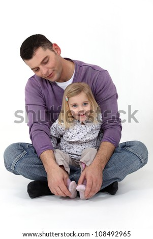 Man spending time with his daughter - stock photo