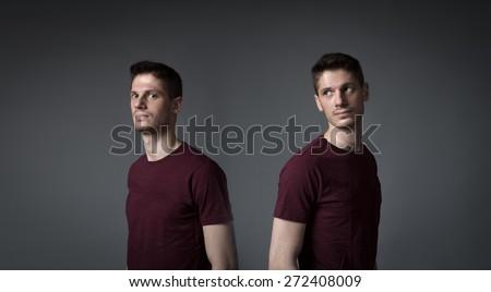 man splitting in two portrait, dark background - stock photo