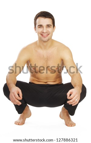 Man squatting down in bare feet