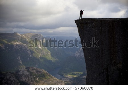 Man stand on the rock. - stock photo