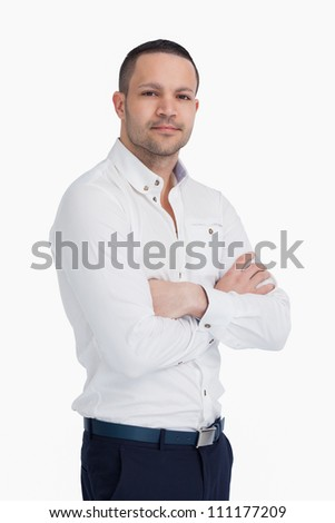 Man standing and crossing his arms against a white background - stock photo