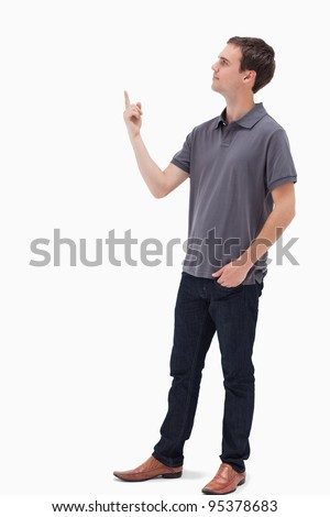 Man standing and presenting something above against white background - stock photo