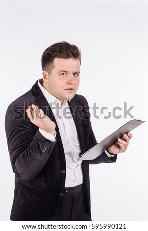 man standing and writing in folder on a white background. People and emotional concept