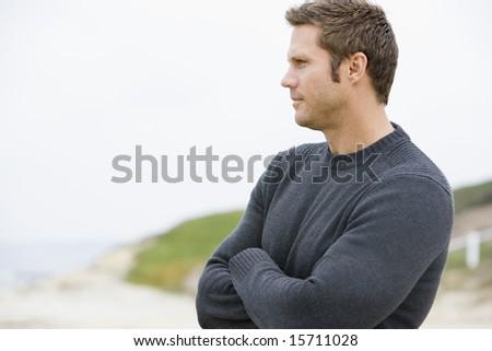 Man standing at beach - stock photo