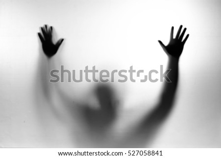 Man standing behind frosted glass. Image creates feeling of depression, Man behind a screen, Blurry shadow