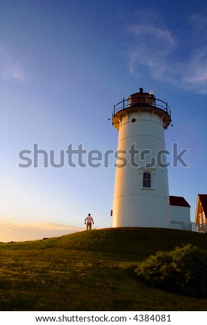 Man standing by Nobska Lighthouse on Cape Cod - stock photo