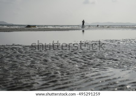 Man standing by the sea