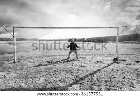Man standing in a soccer goal - stock photo