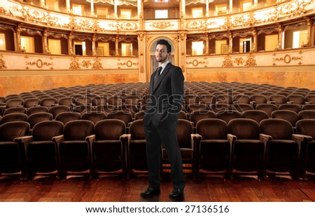 man standing in a theater