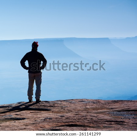 Man standing in Canyonlands National Park - stock photo