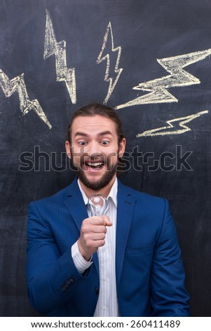Man standing in front of blackboard background
