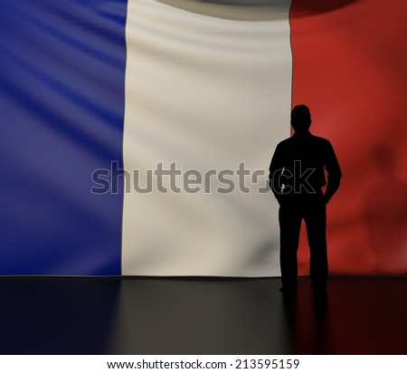 Man standing in front of flag of france; stage presentations - stock photo