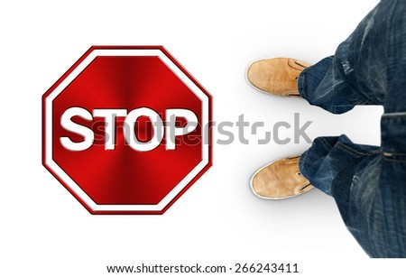 Man standing in front of the red sign stop - stock photo