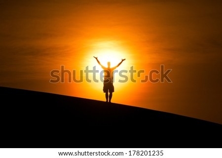 man standing in front of the sun