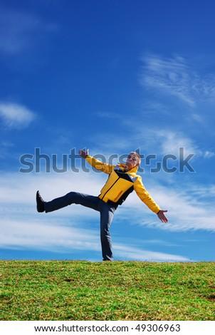 Man standing in funny pose. Fun scene. - stock photo