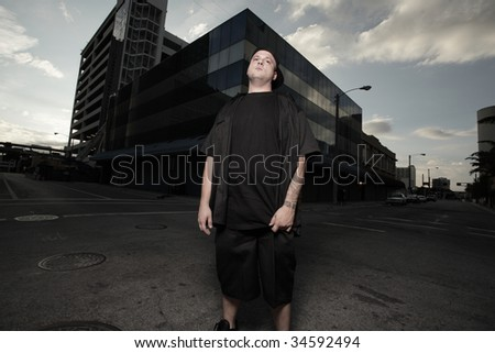Man standing in the middle of the street