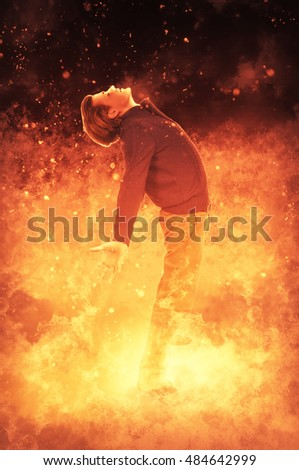 Man standing in the midst of a fire