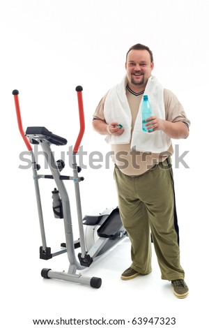 Man standing near an exercising device drinking water and resting - isolated - stock photo