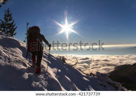 Man standing on a snowy slope - stock photo