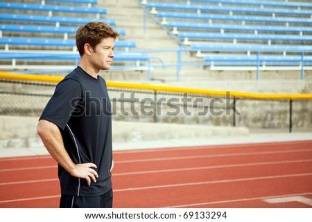 Man standing on a track outside - stock photo