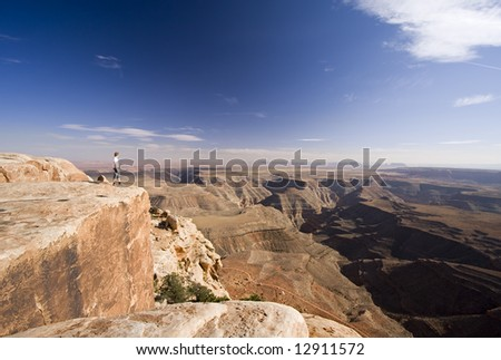 Man standing on cliff edge, Muley Point, Utah
