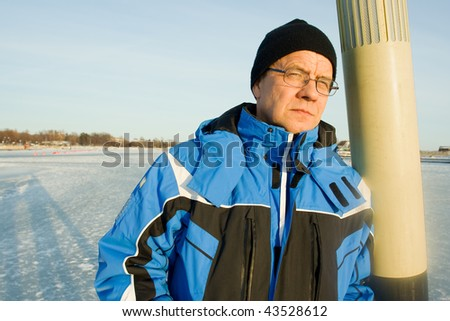 Man standing on ice - stock photo