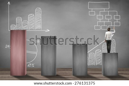 man standing on lower stage and writing business project