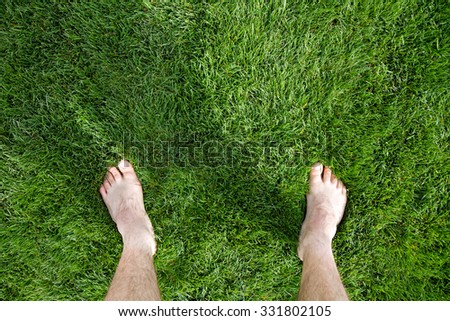 Man standing on some grass during a sunny day