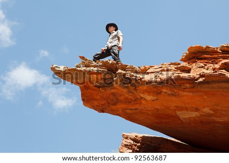Man standing on the rock edge, Western Australia outback - stock photo