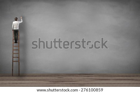 man standing on the stairs and writing something - stock photo