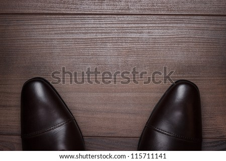 man standing on the wooden floor background - stock photo