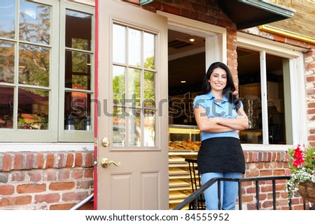 Man standing outside bakery/cafe
