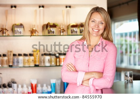 Man standing outside bakery/cafe - stock photo