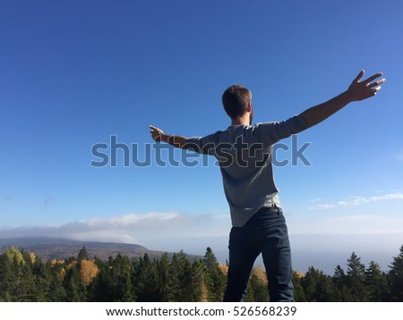Man Standing With Arms Out | Nature Clouds Sky Trees Forest