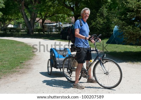 man standing with bike and doggy ride
