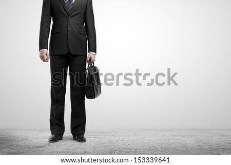 man standing with briefcase on white backgrounds