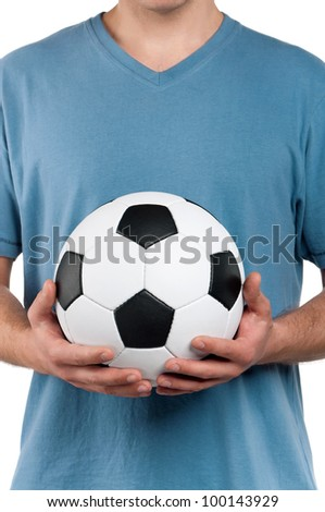 Man standing with classic soccer ball on isolated white background - stock photo