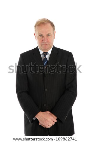 Man standing with hands folded Middle-aged buisnessman standing facing the camera with his hands folded in front of him isolated on white