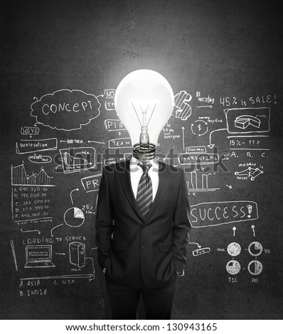 man standing with lighbulb in head - stock photo