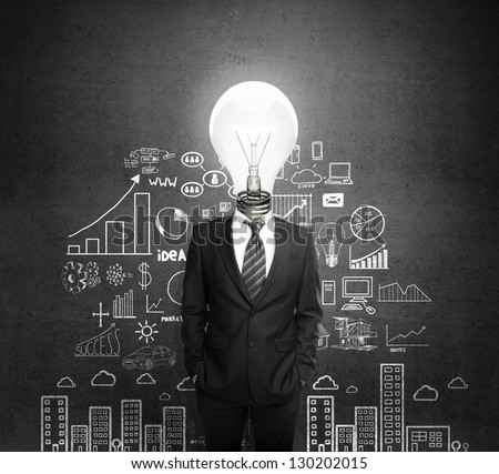 man standing with light bulb in head - stock photo