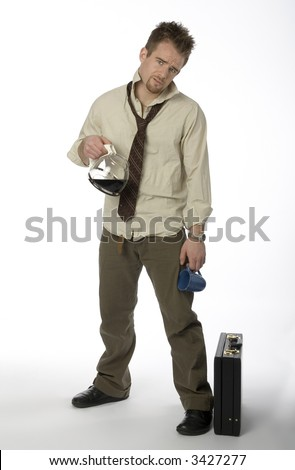 Man standing with wrinkled shirt, loose necktie, coffee pot, and briefcase - stock photo