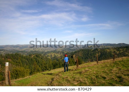 Man stands at one of the highest points in Sonoma County looking out over a vast expanse - stock photo