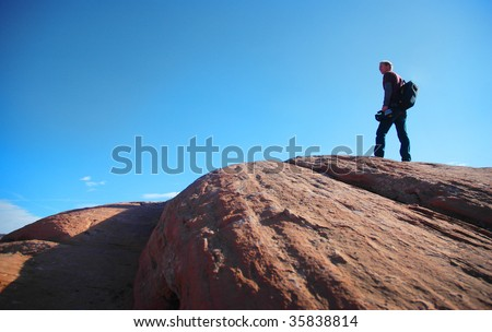 Man stands on a rock.