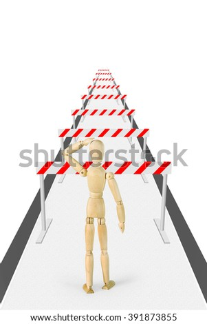 Man stands on the way with a lot of barriers. Abstract image with a wooden puppet - stock photo