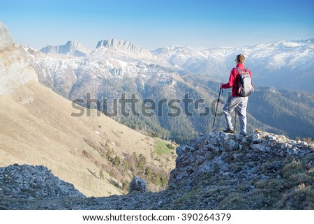 Man staring at the mountains. - stock photo