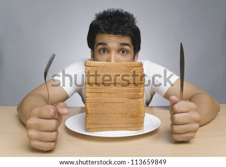 Man staring at the slices of bread - stock photo