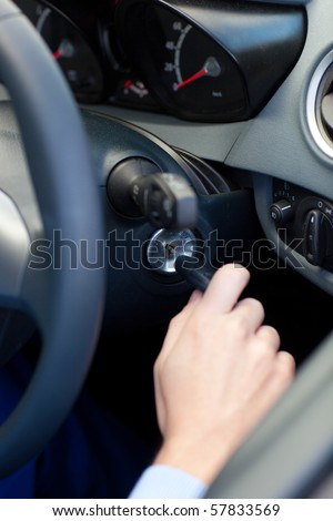 Man starting a car with his car key - stock photo