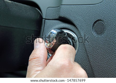 Man starting the car - stock photo
